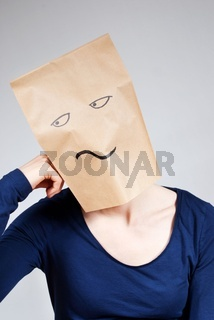 a person symbolizing boredom with a paper bag face