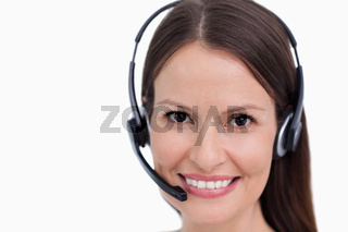 Close up of smiling female call center employee