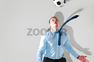 business man is playing football