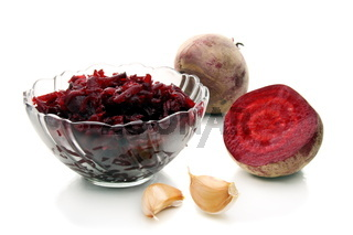 Salad of roasted beets in glass salad bowl.