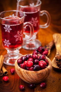 Cranberries in wooden bowl with hot mulled wine