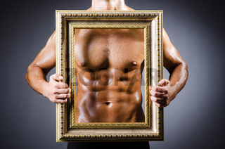 Muscular man with picture frame
