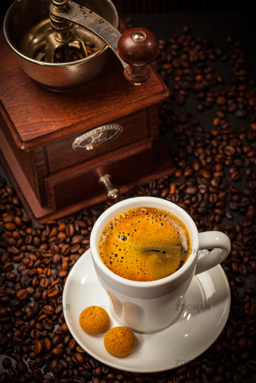 Espresso cup with coffee mill and beans