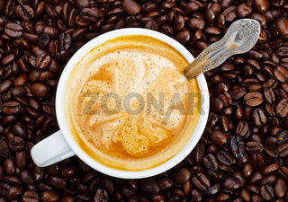 espresso cup in coffee beans