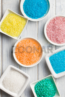 different colours of bath salt