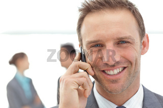 Portrait of a businessman on the phone during a meeting