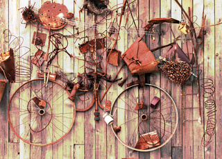 Still-life of rusty metal items on wooden background.