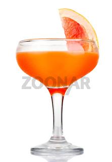 Orange alcohol cocktail with fruit slice isolated on white