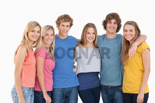 A group of friends smiling and holding each other