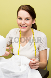 Brunette woman sewing