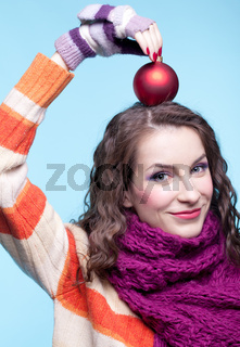 Woman with Christmas ball