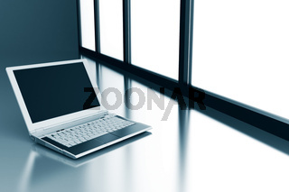 laptop on a smooth surface and light from a window