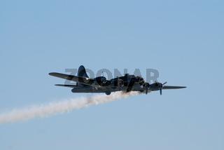 Boeing B-17 flies with smoke trail