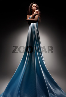beautiful brunette in long dress