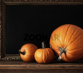 Different sized pumpkins on table
