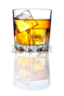 Whiskey glass with ice cubes and reflections