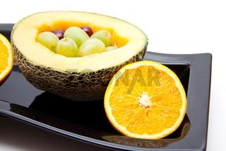 Melone mit Trauben und Orange