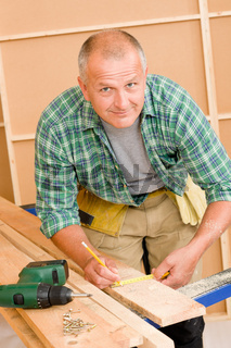 Handyman home improvement close-up of measure wood