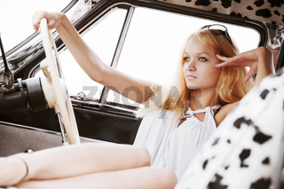 Young woman in a retro car