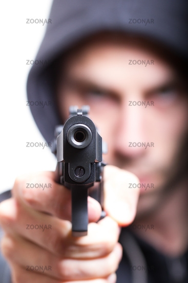 Man with gun, gangster, focus on the gun