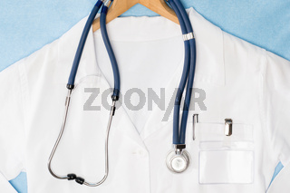 Medical lab coat hanging on hanger stethoscope