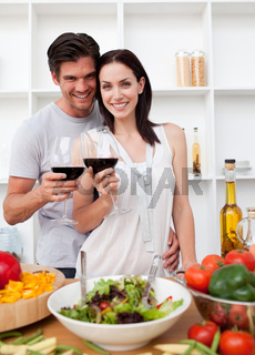 Smiling couple toasting and cooking
