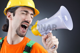 Construction worker with loudspeaker in studio
