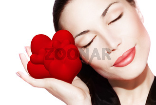 Beautiful woman holding many red hearts