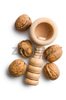 wooden nutcracker and walnuts