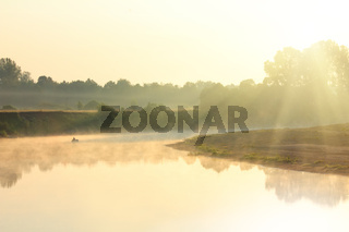 fishing on river in fog
