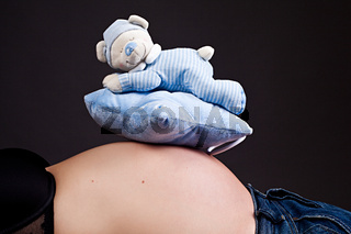 Baby music box on pregnant belly