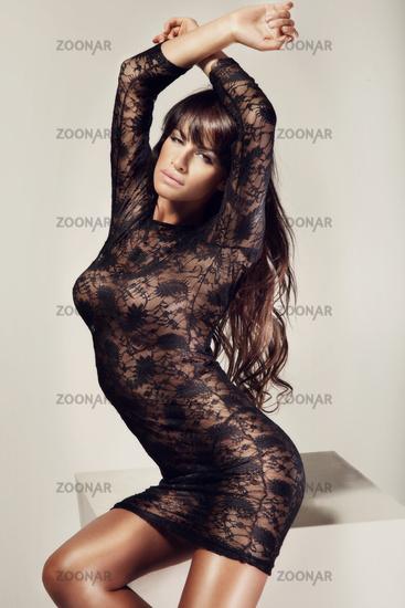Full portrait of a beautiful adult sensuality woman in black dress