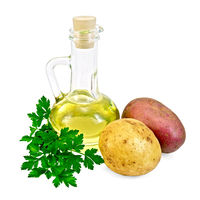 Potatoes red and yellow  with a bottle of oil