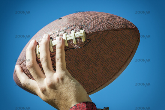 hand with american football
