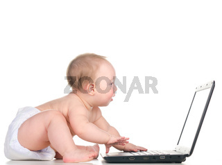 baby is working on laptop