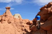 Photographer Shooting Sandstone Rock Formation (Hoodoo) in Goblin Valley State Park in Utah