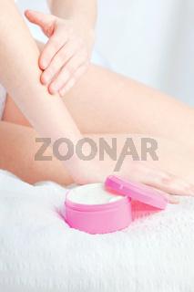 woman's hand applying cream