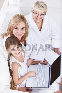 Families with a laptop on a white sofa