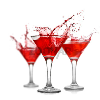 Red cocktails with splash isolated on white