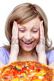 Smiling woman holding a pizza