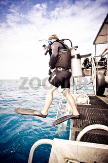 Deep sea diver stepping off the deck