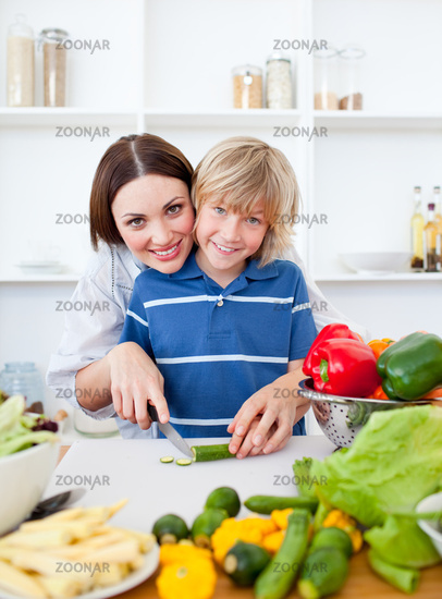 Caring mother and her son cooking