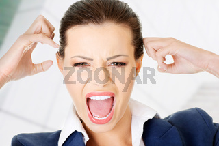 Stressed or angry businesswoman screaming