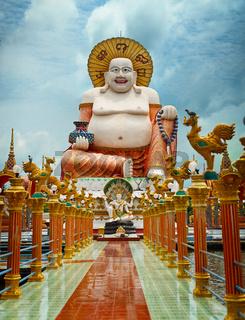 Big laughing Buddha statue. Wat Plai Laem, Samui, Thailand