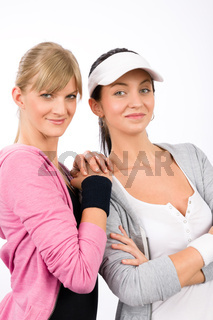 Two sport woman friends smiling