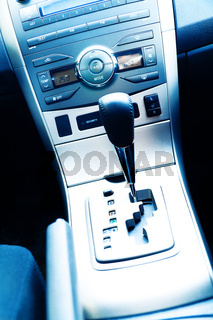Interior of the modern car with buttons and the lever
