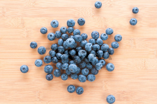 Fresh blue berries group on wooden back