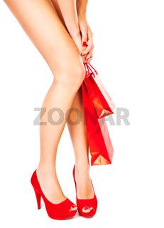 Beautiful female legs, red fashion, shopping concept