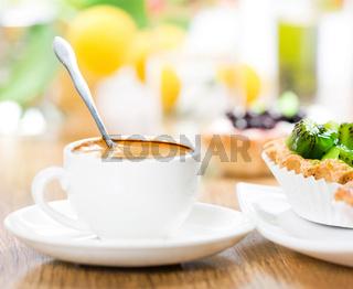 Fruit dessert and coffee