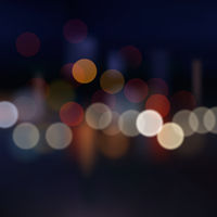 Blurred city at night, vector background.
